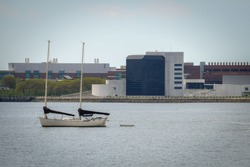 A presidential library in Boston, with a sailboat nearby