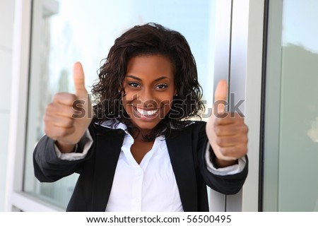 A pretty african american business woman with thumbs up