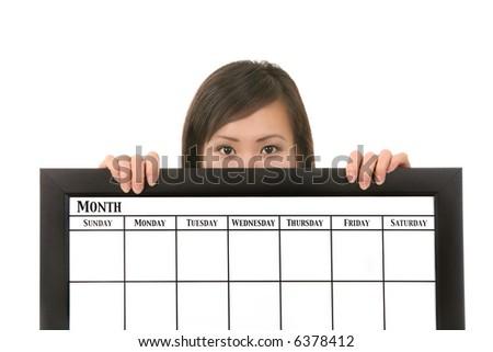 A pretty asian business woman holding a calendar