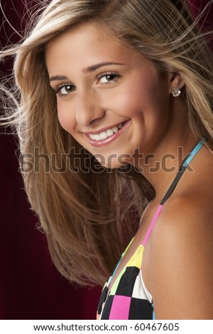stock photo : a pretty blond young teen girl wearing a colorful bikini ...