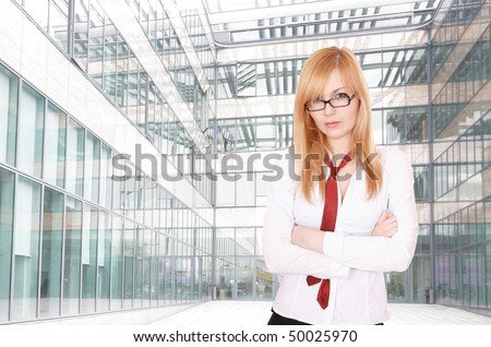 A pretty business woman at his company office building