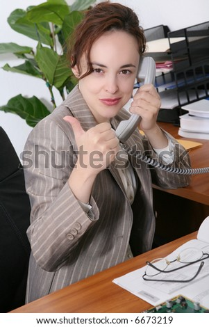 A pretty business woman on the phone