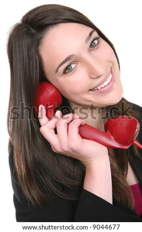A pretty business woman talking on a red phone