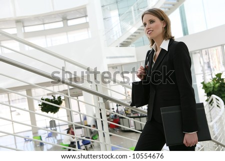 A pretty business woman walking up the stairs