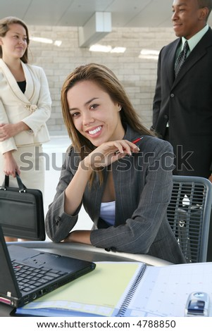 A pretty business woman working on her laptop computer