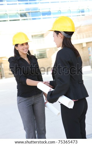 A pretty business women handshake doing construction at office building