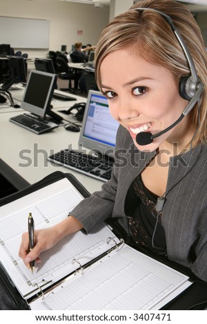 A pretty customer service woman taking notes