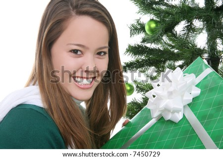 A pretty girl at Christmas opening her presents