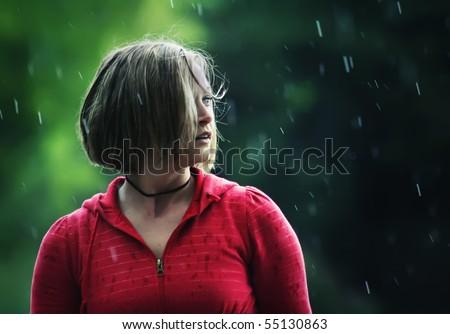 a pretty girl caught in a rain storm