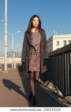 Pretty girl is walking down the street stock photo