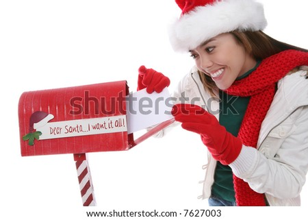 A pretty girl mailing her letter to santa claus at Christmas