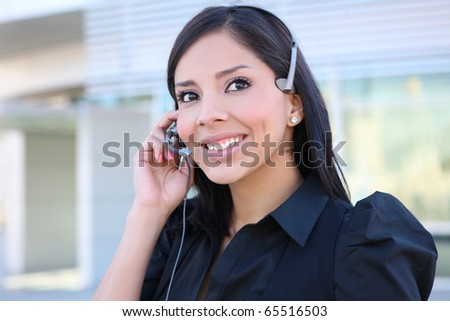 A pretty hispanic customer service business woman on the phone