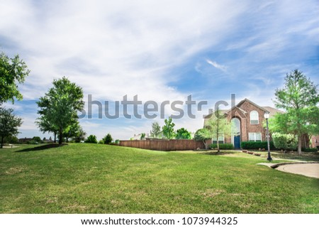 A pretty home with green lawn #1073944325