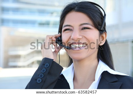 A pretty Indian customer service business woman at office building