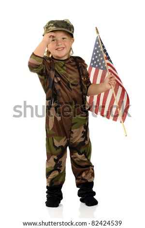 "A pretty preschool ""soldier"" happily solutes while holding an American flag.  Isolated."
