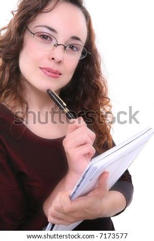 A pretty professional woman thinking about a problem - stock photo