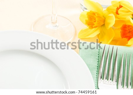 A pretty table setting in white, green and yellow has ample copy space for Spring and Mother's Day promotions