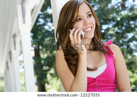 A pretty teenage girl on the cell phone at home
