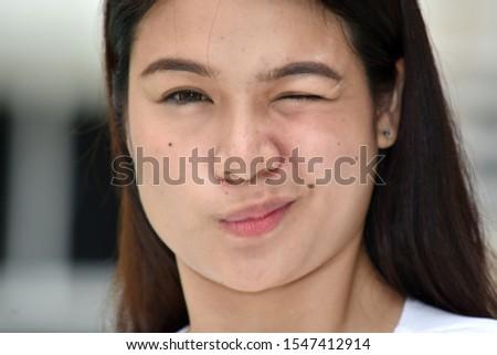 A Pretty Winking Diverse Female