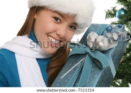 A pretty woman at Christmas holding her presents