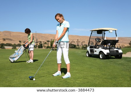 A pretty woman golfer ready to begin the golf course