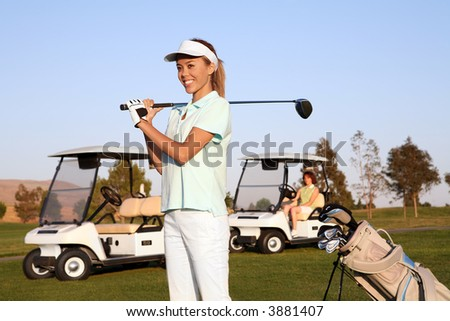 A pretty woman golfer ready to hit on the fairway