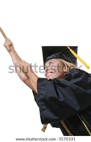 A pretty woman graduate hanging on to rope