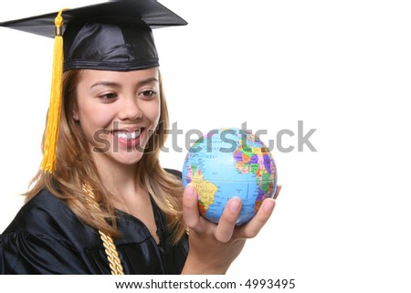 A pretty woman graduate holding a small globe