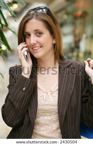 A pretty woman on the phone inside a mall