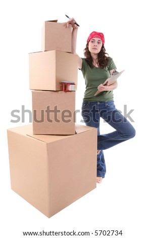 A pretty woman packing her shipment and making plans