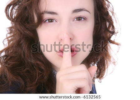 A pretty woman signaling for silence with her finger