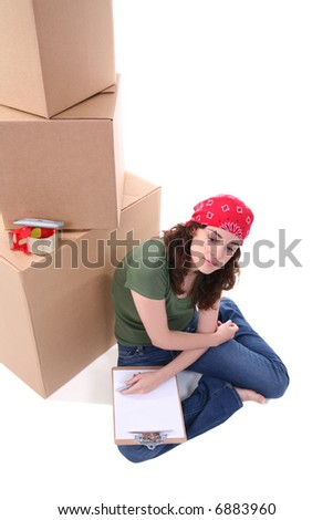 A pretty woman working packing her shipment