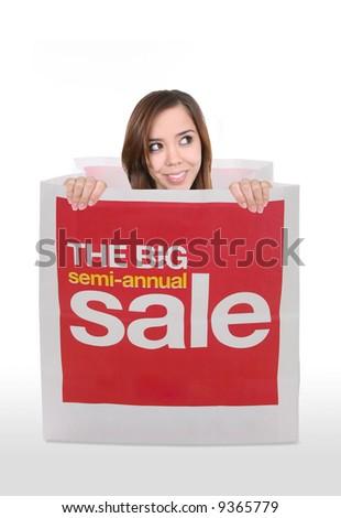 A pretty women inside a shopping sale bag