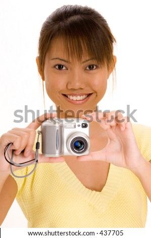A pretty young asian girl with a point and shoot digital camera