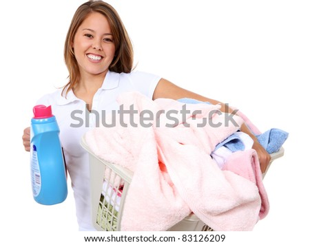 A pretty young woman doing laundry at home