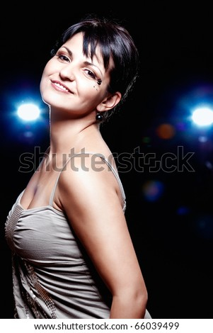 A pretty young woman enjoying the night life (intentional flare)