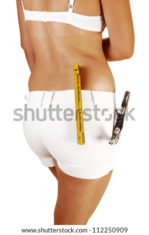 A pretty young woman from the back in white shorts and bra with some tools in her shorts on the way to fix the problem, on white background.