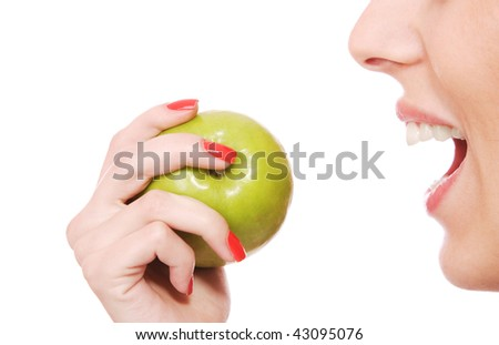 A pretty young woman holding an apple she's about to eat