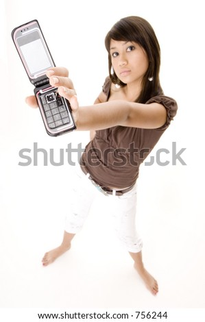 A pretty young woman holds up her clamshell phone