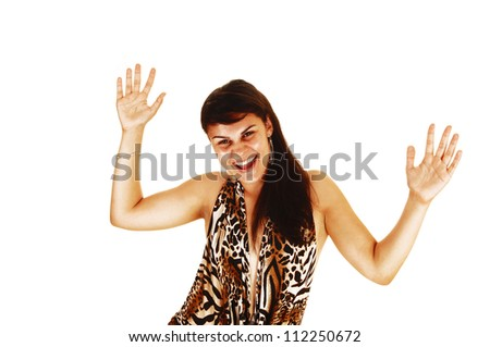 A pretty young woman is so happy, lifting her hands in the air and smiling for the surprise she got, in white background.