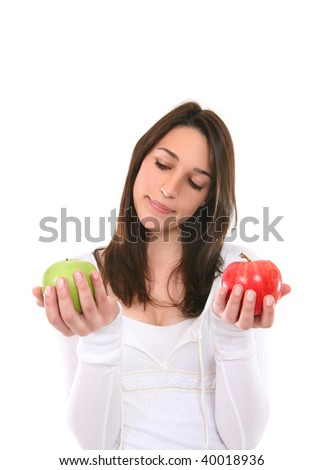 A pretty young woman making a decision on which apple