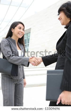 A pretty young women business team at the office building shaking hands
