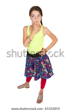 A primary aged girl looking puzzled about something. - stock photo
