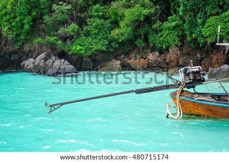 A primitive outboard motor used to power wooden boats in and around the PhiPhi Islands on the Andaman Sea in Thailand. - Shutterstock ID 480715174