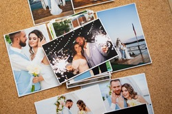 a printed copy of the wedding photos. the result of a photo session of the bride and groom.