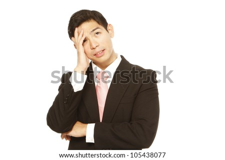 A problematic businessman thinking - stock photo