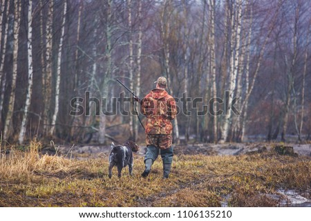 A process of hunting during hunting season, process of duck hunting, group of hunters and drathaar, german wirehaired pointer dog  #1106135210