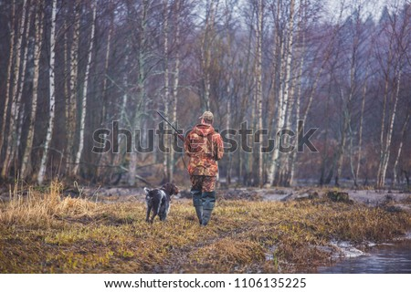 A process of hunting during hunting season, process of duck hunting, group of hunters and drathaar, german wirehaired pointer dog  #1106135225