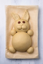 A process of making Easter Bunny Buns of delicious sweet dough. Do it yourself. Step by step instruction. Step 4. Make of almond petals a teeth and an ears of dough
