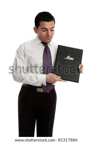 A professional businessman, waiter, restauranteur holding and presenting a black leatherbound folder.